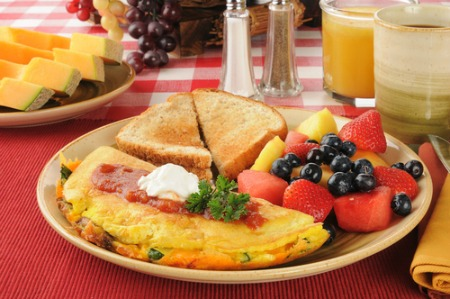 Plate with western omelet, mixed fruit, and toast